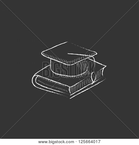 Graduation cap laying on book. Drawn in chalk icon.