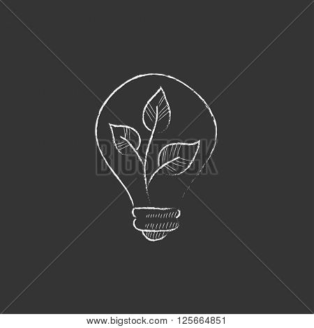 Lightbulb and plant inside. Drawn in chalk icon.