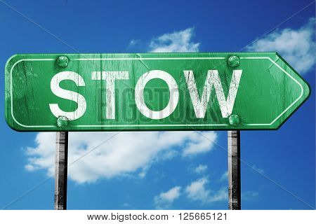 stow road sign on a blue sky background