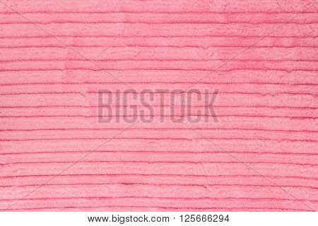 Ribbed pink corduroy texture. Useful for background