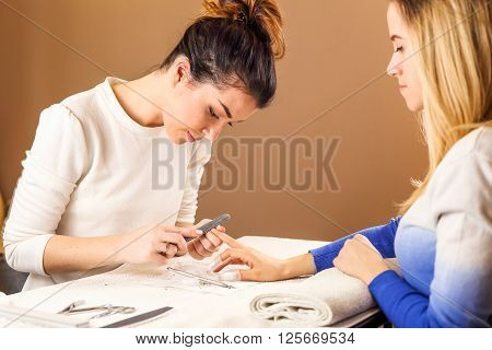 Nail polish removal process on brown background