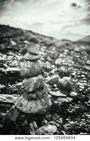 Stack Of Rocks Stones, On Blurred Background, On Norwegian Mountain, Norway Nature.