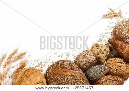 Top view of cereal bread ears of wheat and different seeds isolated on white background.