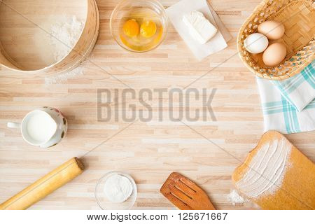 Ingridients For Bread Baking On Light Wooden Background  With Copyspace. Cutting Board, Eggs, Salt,