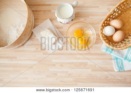 Ingridients For Bread Baking On Light Wooden Background  With Copyspace. Eggs In Braided Bucket, Flo