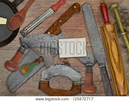 vintage bakery shop tools and utensils over stained wooden table blank business card for your text