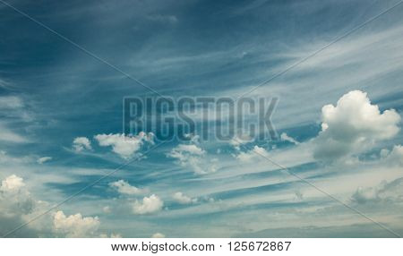 White clouds in a blue fantastic sky. Great background. horizontal