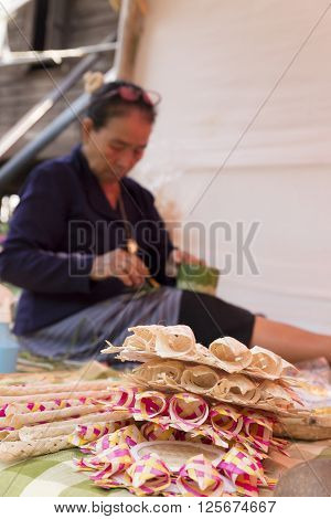 Old Woman Folding Banana Leaf