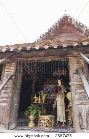 CHIANG MAI, THAILAND - APRIL 13: dummy with ancient Thai dress showing for tourist at the ancient lanna house 140 years in water festival 2016.
