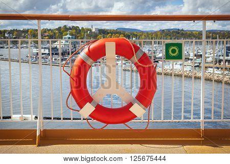 Orange Lifebuoy. Concept of safe sea walk