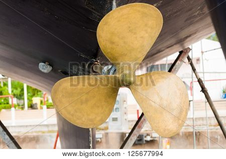 Brass ship propeller check up at the shipyard