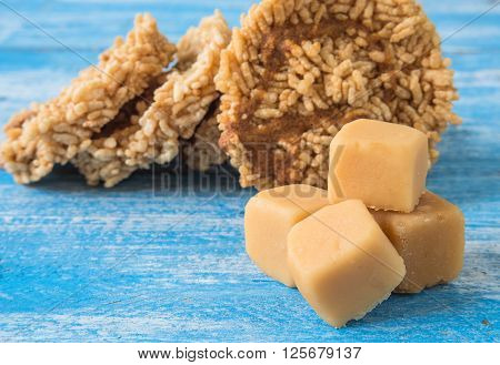 Coconut sugar Cube sugar Rice Crackers on Blue background.Focus coconut sugar.