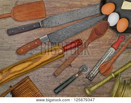 vintage bakery shop tools and utensils over stained wooden table