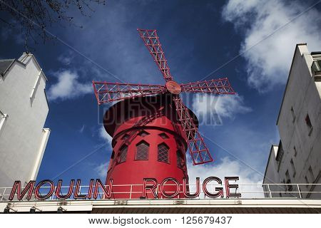 PARIS, FRANCE - MARCH 27, 2016: The Moulin Rouge, Paris, France. Moulin Rouge is a famous cabaret built in 1889, locating in the Paris red-light district of Pigalle.