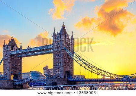 London, UK - March 31, 2016 - Tower Bridge and St. Katharine Pier against orange sunset sky