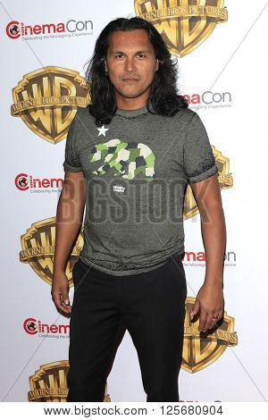 LAS VEGAS - APR 12: Adam Beach at the Warner Bros. Pictures Presentation during CinemaCon at Caesars Palace on April 12, 2016 in Las Vegas, Nevada