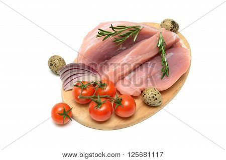 pork vegetables and quail eggs on a cutting board. white background - horizontal photo.