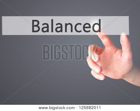 Balanced  - Hand Pressing A Button On Blurred Background Concept On Visual Screen.