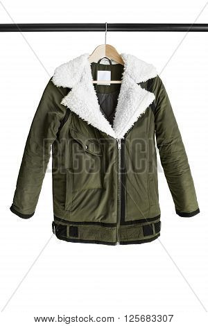 Casual khaki jacket hanging on clothes rack isolated over white