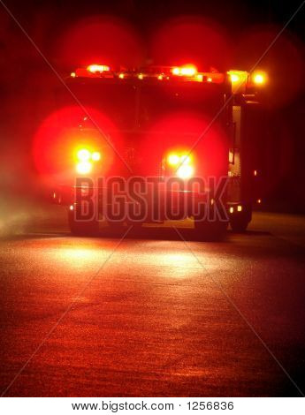 Fire Truck with Emergency Lights Driving at Night