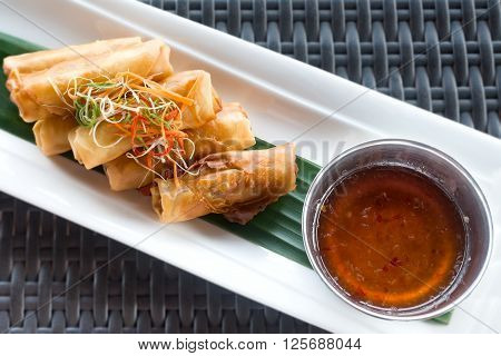 Vegetable fried spring rolls served with bittersweet sauce