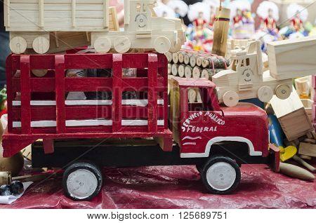 OAXACA, OAXACA, MEXICO- MARCH 21, 2016 Wooden red toy car. Handicraft from Oaxaca, Mexico