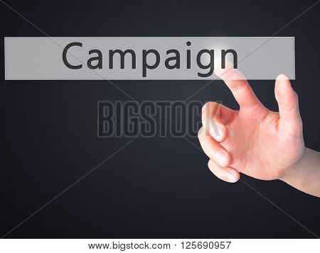 Campaign - Hand Pressing A Button On Blurred Background Concept On Visual Screen.