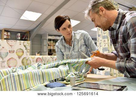 People working in tapestry workshop