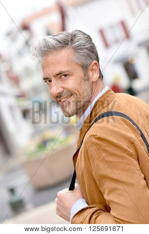 Portrait of mature handsome man in town