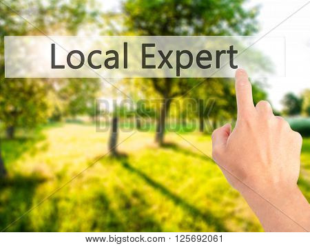 Local Expert - Hand Pressing A Button On Blurred Background Concept On Visual Screen.