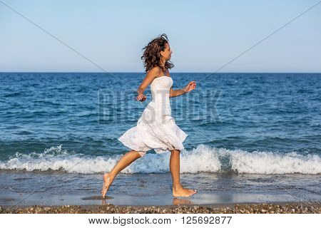 Woman running along the beach.