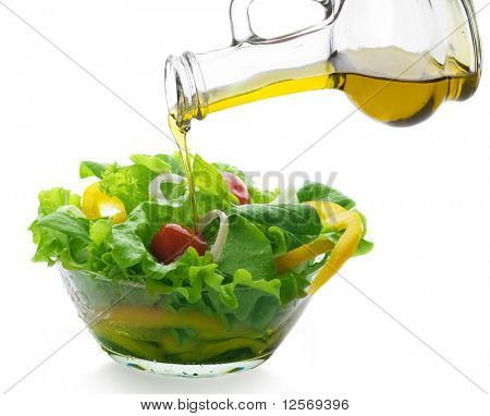 Healthy Vegetable Salad and pouring oil