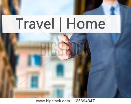 Travel  Home - Businessman Hand Holding Sign