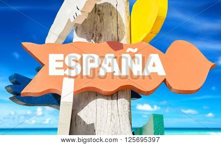Spain (in Spanish) signpost with beach background