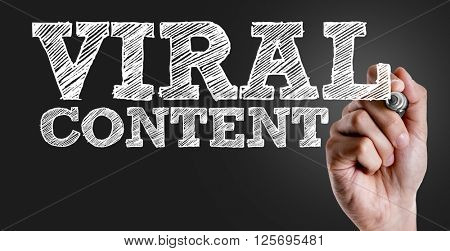 Hand writing the text: Viral Content