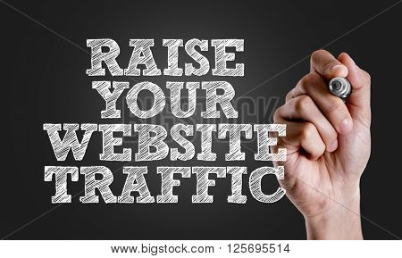 Hand writing the text: Raise Your Website Traffic
