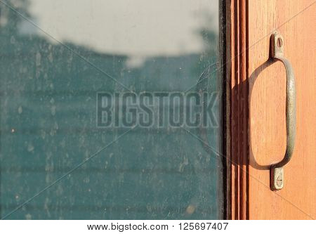 close-up old wooden window with hand open lorn window