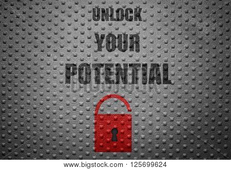 Red lock on metal background with Unlock Your Potential text