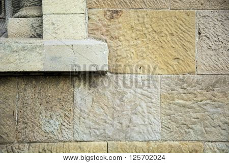 Elegant photo of a stone wall with sunlight and brown colour