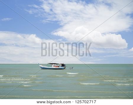 Boat on the sea under blue sky and cloud at Khao Sam Roi Yot National Park in Thailand