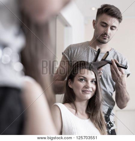 Straightening Hair In Hairdresser Salon