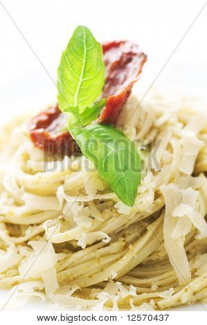 Italian Pasta with Pesto sauce,Parmesan cheese,fresh basil and dried tomato