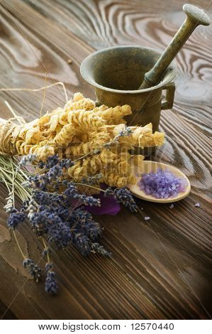 Herbs and antique mortar with pestle