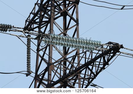 High-voltage electrical insulator electric line against the blue sky