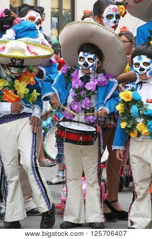 Cajamarca Peru - February 7 2016: Group of people marching in Day of the Dead Costumes in Carnival Parade Cajamarca Peru on February 7 2016