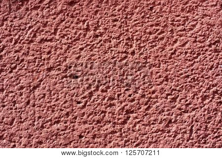 coarse red brown plaster wall for background or texture