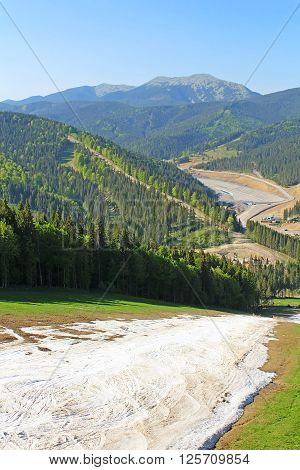 BUKOVEL, UKRAINE - MAY 11, 2013: Bukovel ski resort in May, Carpathian mountains, Ukraine
