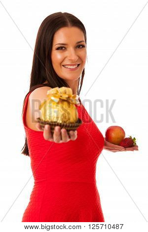 Woman Deciding To Eat Healthy Fruit Or Chocolate Candy.