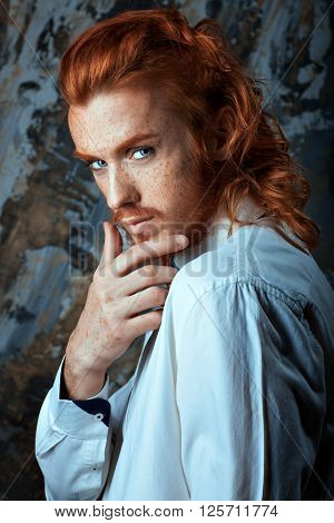 Red-haired man with a beard and mustache he is metrosexual.