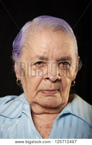 portrait of grandma isolated on black background